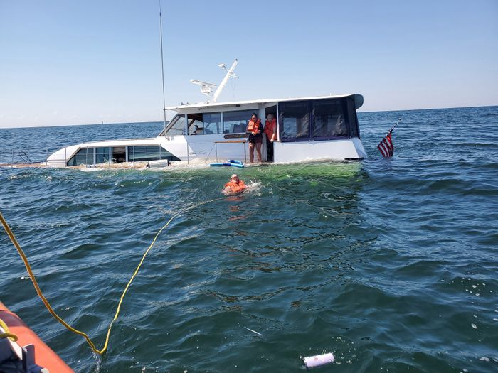 USCG Rescues 5 People, Dog From Sinking 52-Foot Boat Saginaw Bay, Michigan