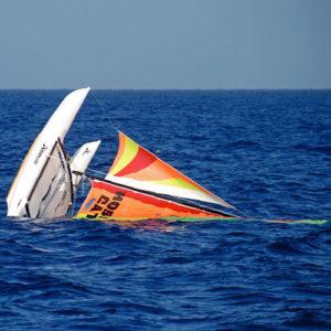 Abandoned catamaran floating in the ocean
