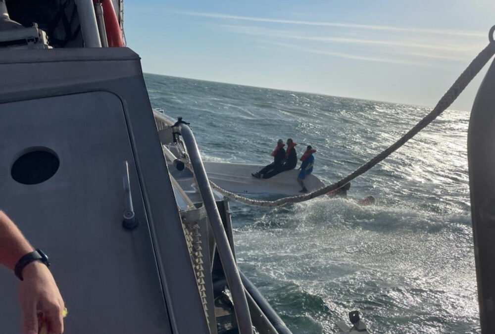 USCG Rescues 5 People from Sinking Boat at Oregon Inlet